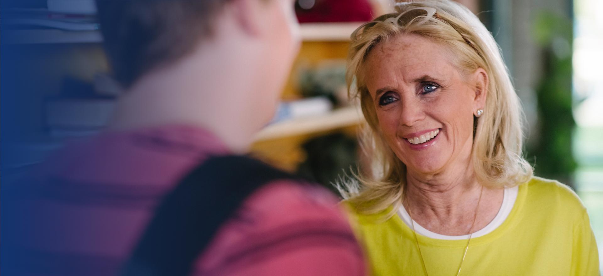 Debbie speaking to student